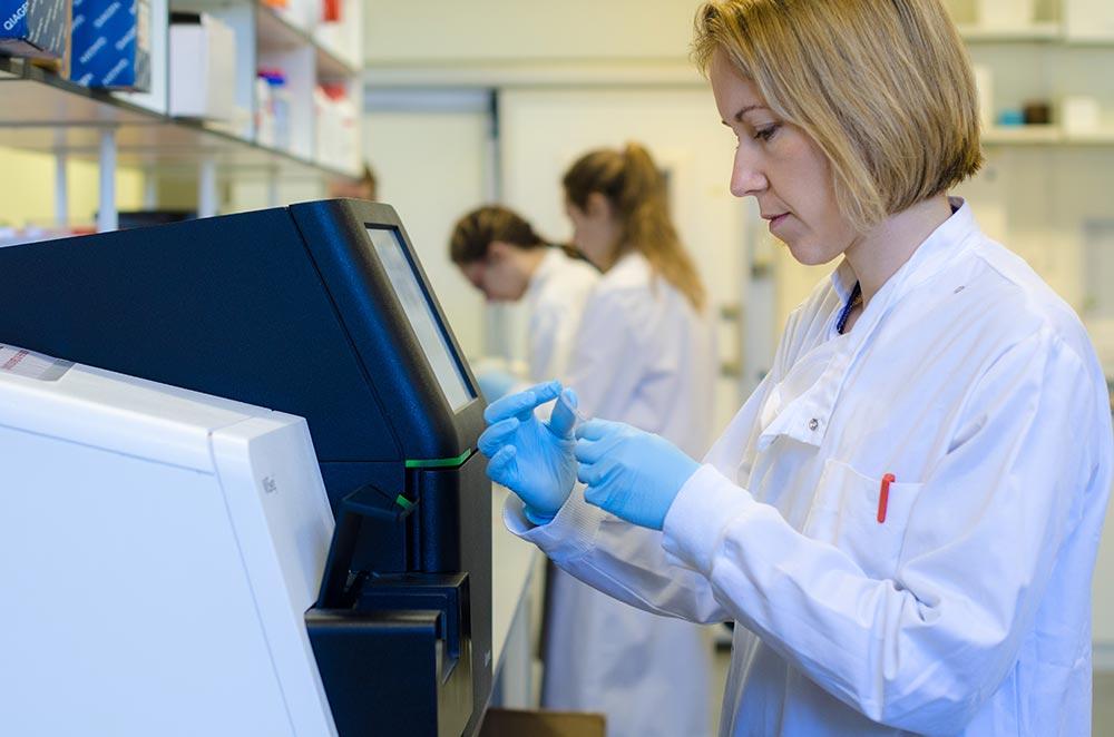 researcher preparing a sample