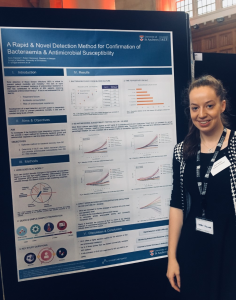 Kerry Falconer presenting her poster at a conference
